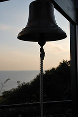 a bell and a sunset