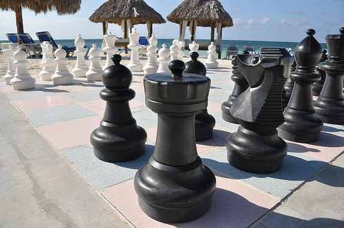 Giant chess set on beach